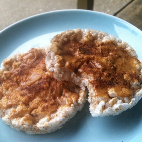 My favorite snack: rice cakes smothered in all-natural PB and sprinkled with cinnamon & stevia